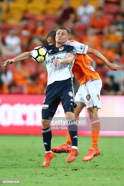 Daniel Bowles of the Roar and Besart Berisha of the Victory compete for the ball during the round 11 ALeague match between the Brisbane Roar and the...