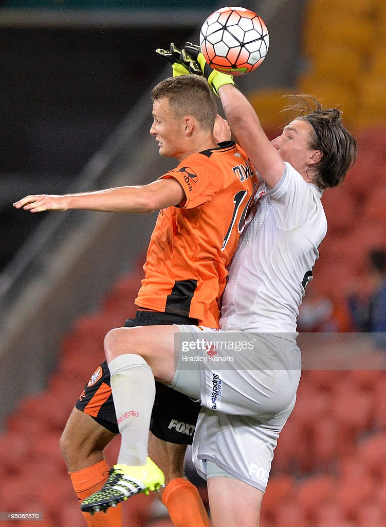 Daniel Bowles of the Roar and John Hall of Adelaide collide as they compete for the ball during the round four A-League match between Brisbane Roar and Adelaide United at Suncorp Stadium on October 31, 2015 in Brisbane, Australia.