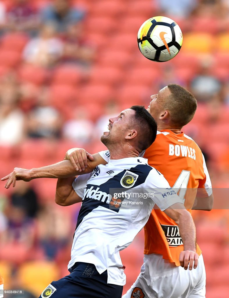 Daniel Bowles of the Roar is pressured by the defence during the round 25 A-League match between the Brisbane Roar and the Central Coast Mariners at Suncorp Stadium on March 31, 2018 in Brisbane, Australia.