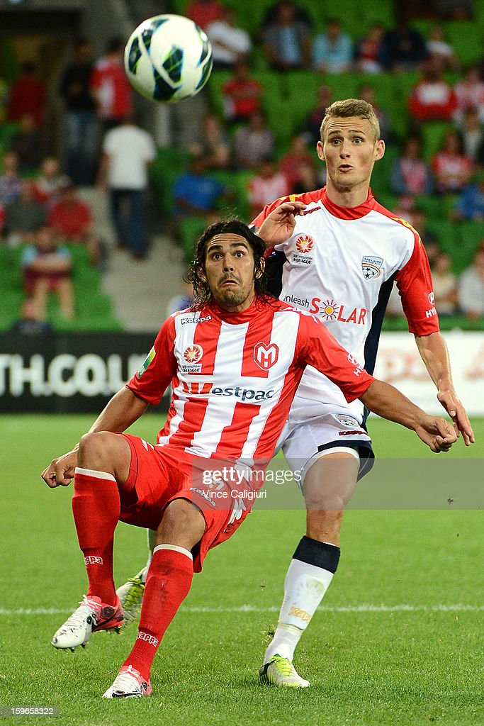 Daniel Bowles of United (R) and David Williams of the Heart contest for the ball during the round seventeen A-League match between Melbourne Heart and Adelaide United at AAMI Park on January 18, 2013 in Melbourne, Australia.