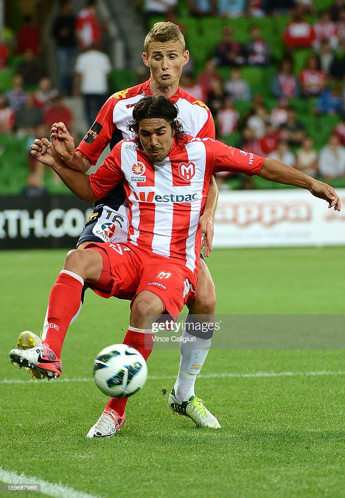 Daniel Bowles of United and David Williams (Front) of the Heart contest for the ball during the round seventeen A-League match between Melbourne Heart and Adelaide United at AAMI Park on January 18, 2013 in Melbourne, Australia.