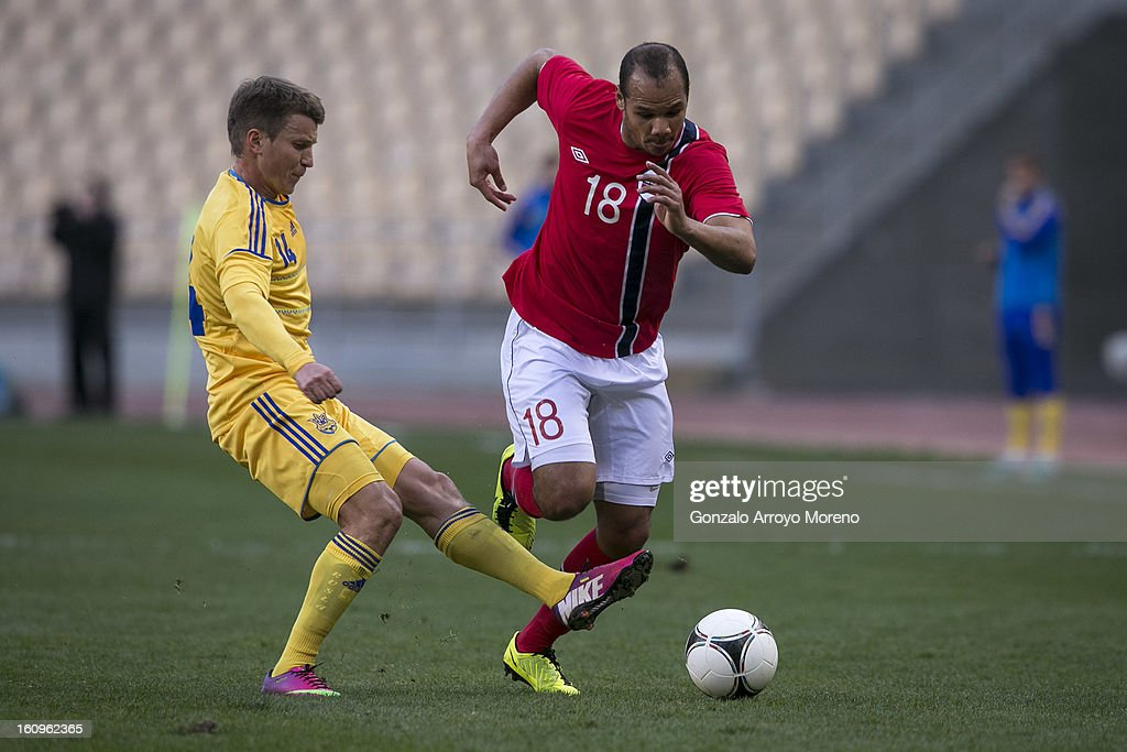 Daniel Braaten (R) of Norway runs for the ball with Ruslan Rotan (L) of Ukraine during the international friendly football match between Norway and Ukraine at Estadio Olimpico de Sevilla on February 6, 2013 in Seville, Spain.