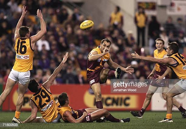 Daniel Bradshaw of the Lions successfully kicks for goal during the round 16 AFL match between the Brisbane Lions and Hawthorn at the Gabba on July...