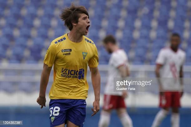 Daniel Braganca of GD Estoril Praia celebrates after scoring a goal during the Liga Pro match between GD Estoril Praia and UD Vilafranquense at...