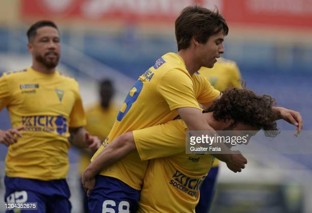 Daniel Braganca of GD Estoril Praia celebrates with teammate Rafael Barbosa of GD Estoril Praia after scoring a goal during the Liga Pro match...