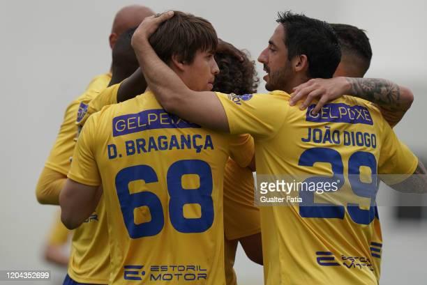 Daniel Braganca of GD Estoril Praia celebrates with teammates after scoring a goal during the Liga Pro match between GD Estoril Praia and UD...