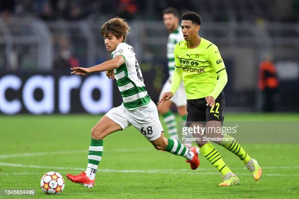 Daniel Braganca of Sporting CP runs with the ball whilst under pressure from Jude Bellingham of Borussia Dortmund during the UEFA Champions League...