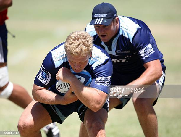 Daniel Braid and Tony Woodcock in action during the Blues training session at Crawford College on February 24, 2011 in Umhlanga, South Africa.