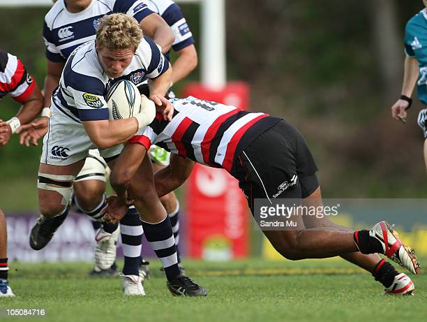 Daniel Braid of Auckland is tackled during the round 11 ITM Cup match between Counties Manukau and Auckland at Bayer Growers Stadium on October 9,...