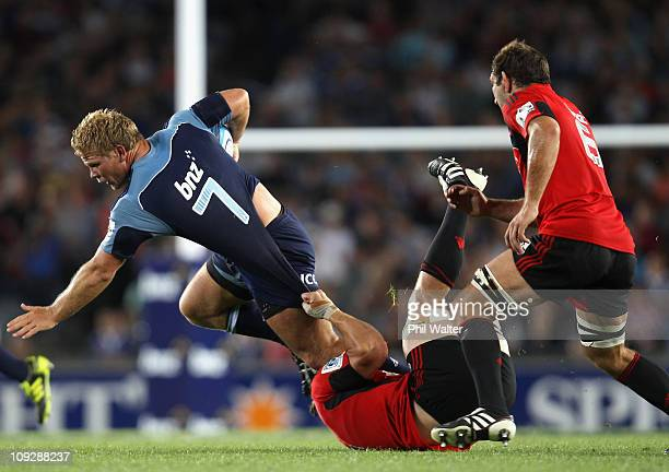 Daniel Braid of the Blues is tackled by Matt Todd of the Crusaders during the round one Super Rugby match between the Blues and the Crusaders at Eden...