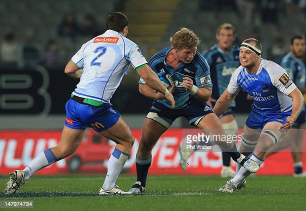Daniel Braid of the Blues looks for a gap in the Force defence during the round 17 Super Rugby match between the Blues and the Force at Eden Park on...