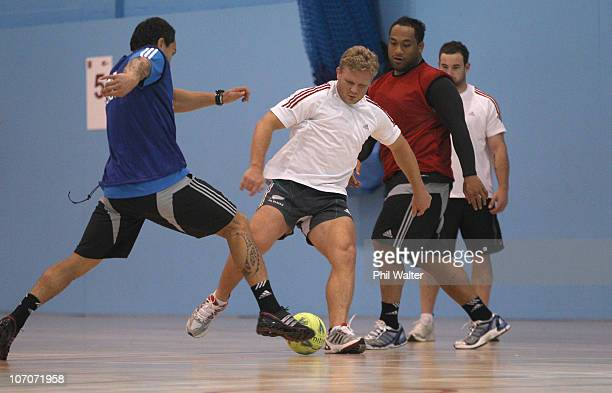 Daniel Braid of the New Zealand All Blacks kicks the ball during a Recovery Session at the Talybont Sports Centre on November 22, 2010 in Cardiff,...