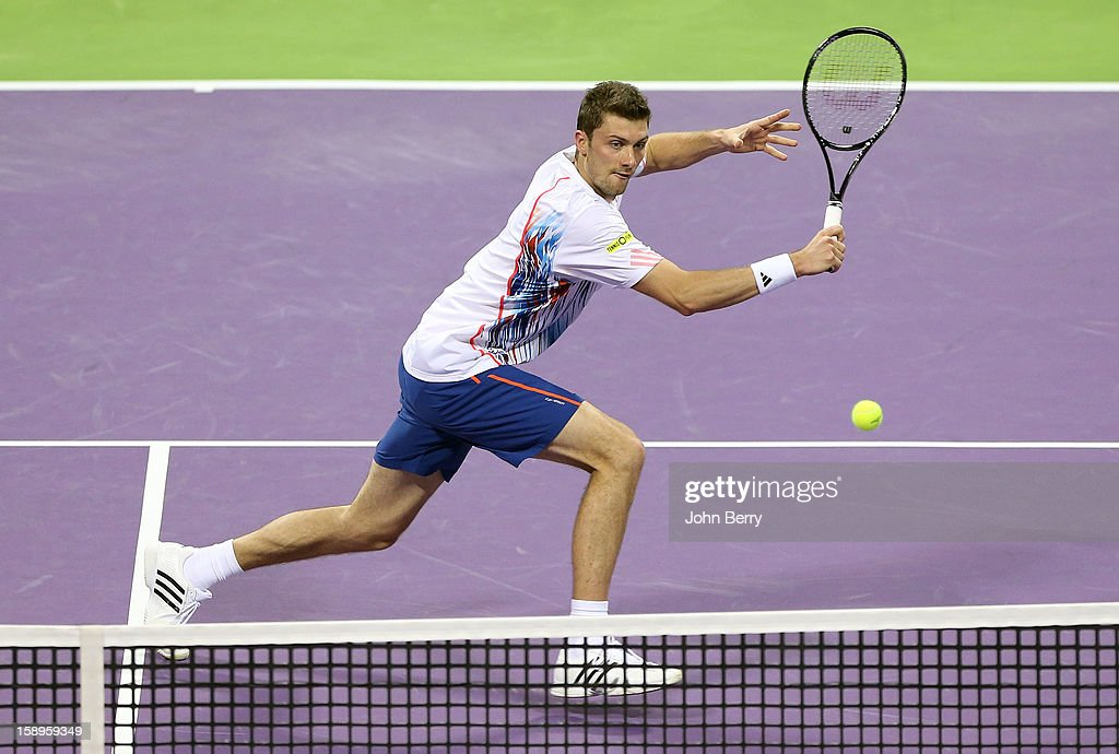 Daniel Brands of Germany plays a backhand volley during his semi-final against Richard Gasquet of France in day five of the Qatar Open 2013 at the Khalifa International Tennis and Squash Complex on January 4, 2013 in Doha, Qatar.