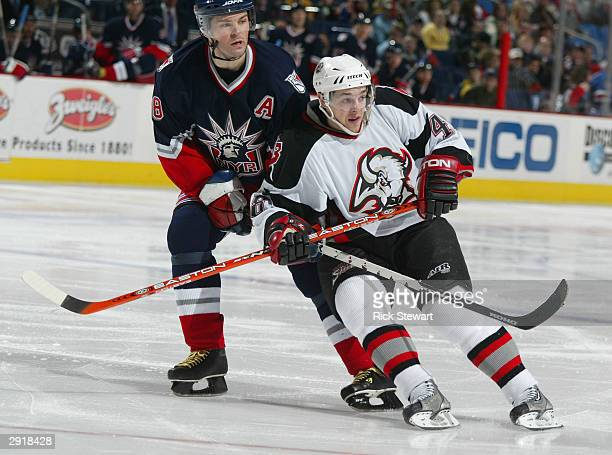 Daniel Briere of the Buffalo Sabres cuts toward the net as Jaromir Jagr of the New York Rangers defends on January 31, 2003 at HSBC Arena in Buffalo,...