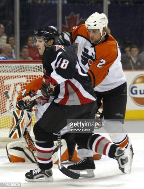 Daniel Briere of the Buffalo Sabres skates away from Derian Hatcher of the Philadelphia Flyers during game 5 of the Eastern Quarter finals at the...
