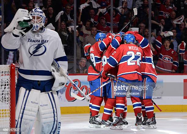 Daniel Briere of the Montreal Canadiens celebrates with teammates Dale Weise Michael Bournival and Francis Bouillon after scoring a goal on Anders...