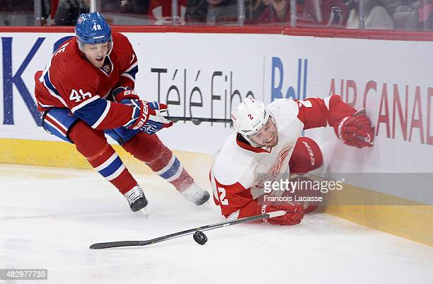 Daniel Briere of the Montreal Canadiens fights for the puck against Brendan Smith of the Detroit Red Wings during the NHL game on April 5 2014 at the...