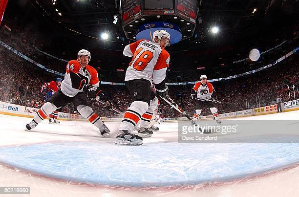 Daniel Briere of the Philadelphia Flyers along with teammates Kimmo Timonen and Mike Richards all skate against the Montreal Canadiens during their...