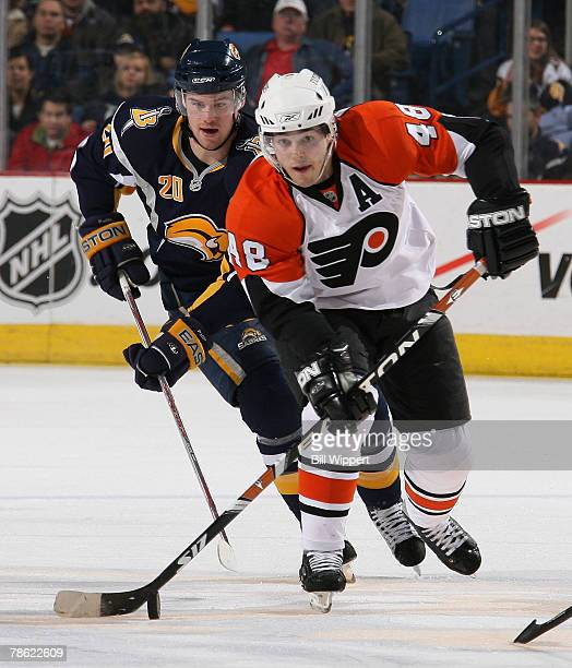 394172f44 Daniel Briere of the Philadelphia Flyers skates with the puck in front of  Daniel Paille of