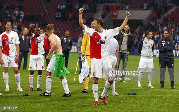 Daniel Brinkmann of Augsburg and his teammates celebrate after the Second Bundesliga match between FC Augsburg and TSV 1860 Muenchen at Impuls Arena...