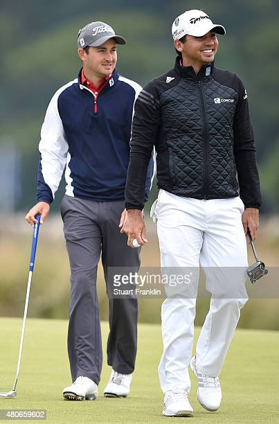 Daniel Brooks of England and Jason Day of Australia look on during practice ahead of the 144th Open Championship at The Old Course on July 14 2015 in...