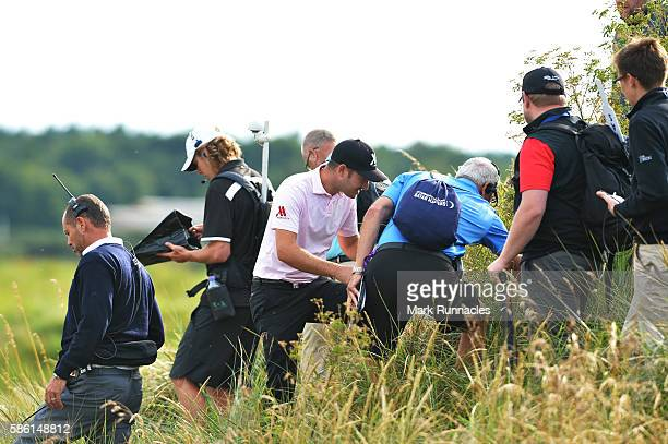 Daniel Brooks of England looks for his ball in the deep rough on hole 16 on day two of the Aberdeen Asset Management Paul Lawrie Matchplay at...