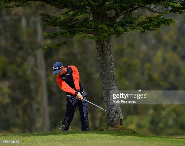 Daniel Brooks of England playing his approach shot to the 3rd green from behind a tree during the Madeira Islands Open - Portugal - BPI at Club de...