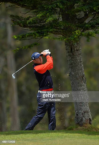 Daniel Brooks of England watches on after playing his approach shot to the 3rd green from behind a tree during the Madeira Islands Open - Portugal -...