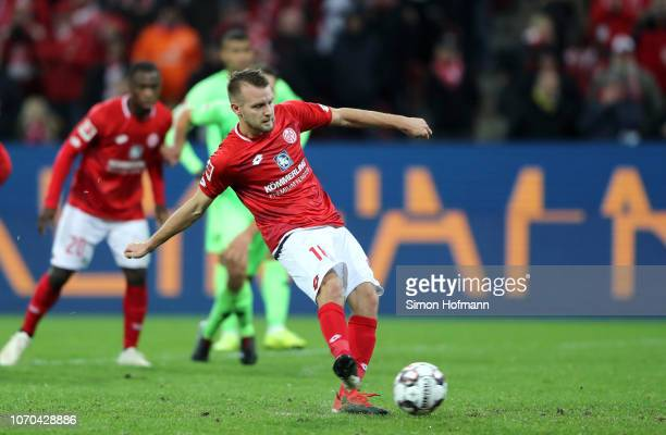 Daniel Brosinski of FSV Mainz scores his team's first goal from a penalty during the Bundesliga match between 1 FSV Mainz 05 and Hannover 96 at Opel...