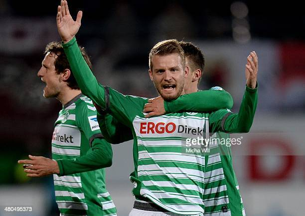 Daniel Brosinski of Fuerth celebrates with teammates after scoring his team's third goal during the second Bundesliga match between Greuther Fuerth...