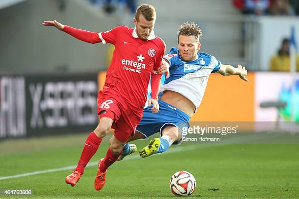 Daniel Brosinski of Mainz is challenged by Eugen Polanski of Hoffenheim during the Bundesliga match between 1899 Hoffenheim and 1 FSV Mainz 05 at...