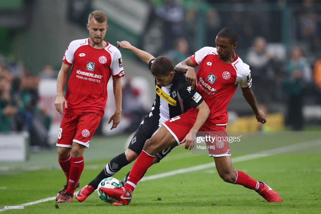 Daniel Brosinski of Mainz, Thorgan Hazard of Moenchengladbach and Abdou Diallo of Mainz fight for the ball during the Bundesliga match between Borussia Moenchengladbach and 1. FSV Mainz 05 at Borussia-Park on November 4, 2017 in Moenchengladbach, Germany.