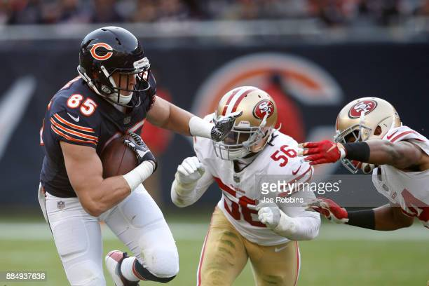 Daniel Brown of the Chicago Bears carries the football against Reuben Foster of the San Francisco 49ers in the fourth quarter at Soldier Field on...