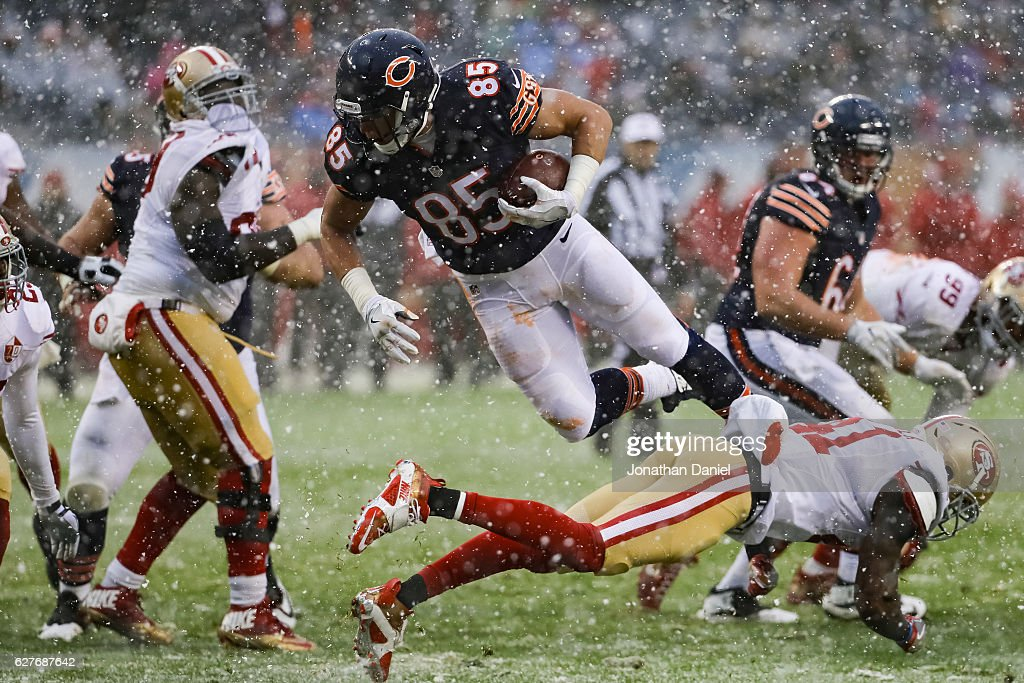 Daniel Brown #85 of the Chicago Bears flys through the air in the third quarter against the San Francisco 49ers at Soldier Field on December 4, 2016 in Chicago, Illinois.