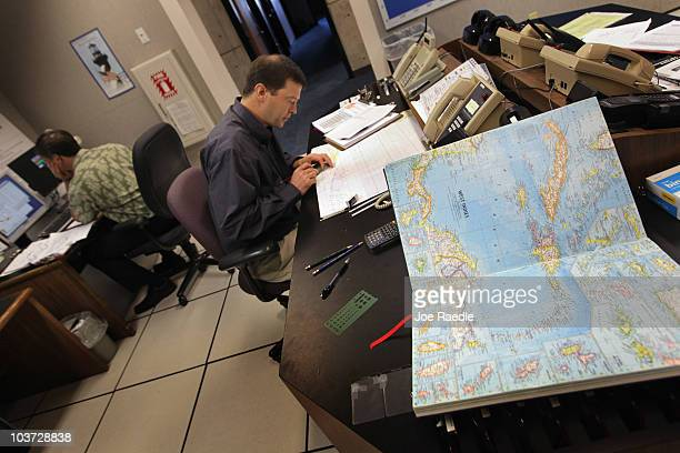 Daniel Brown Senior Hurricane Specialist charts the track of Hurricane Earl at the National Hurricane Center on August 30 2010 in Miami Florida The...