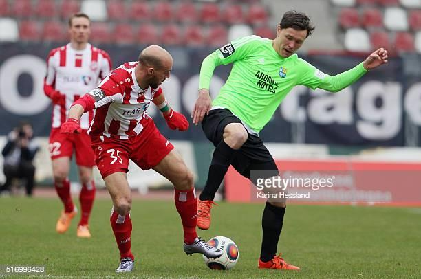 Daniel Brueckner of Erfurt challenges Alexander Bittroff of Chemnitz during the match between FC Rot Weiss Erfurt and Chemnitzer FC at Steigerwald...