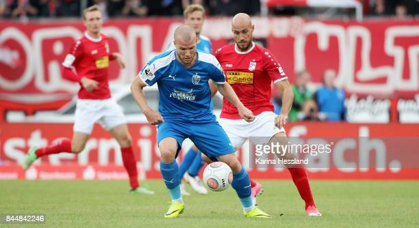 Daniel Brueckner of Erfurt challenges Manfred Starke of Jena during the 3Liga match between FC Rot Weiss Erfurt and FC Carl Zeiss Jena at...