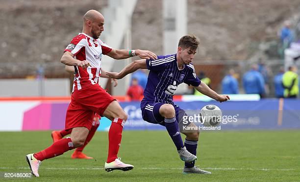 Daniel Brueckner of Erfurt challenges Marcel Kandziora of Osnabrueck during the Third League match between FC Rot Weiss Erfurt and VFL Osnabrueck at...