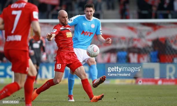Daniel Brueckner of Erfurt challenges Markus Pazurek of Koeln during the third Liga match between FC Rot Weiss Erfurt and SC Fortuna Koeln at...