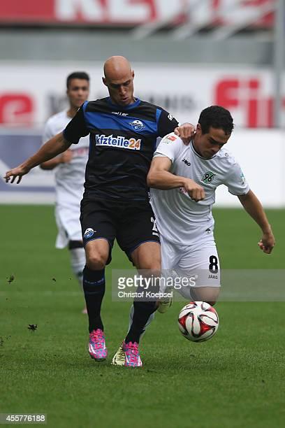 Daniel Brueckner of Paderborn challenges Manuel Schmiedebach of Hannover during the Bundesliga match between SC Paderborn and Hannover 96 at Benteler...