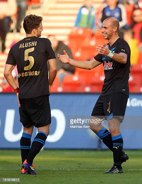 Daniel Brueckner of Paderborn jubilates with team mate Enis Alushi after scoring the first goal during the Second Bundesliga match between FC Energie...