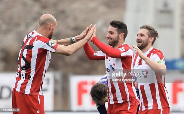 Daniel Brueckner Okan Aydin and Sebastian Tyrala of Erfurt celebrate the third goal by Okan Aydin during the Third League match between FC Rot Weiss...