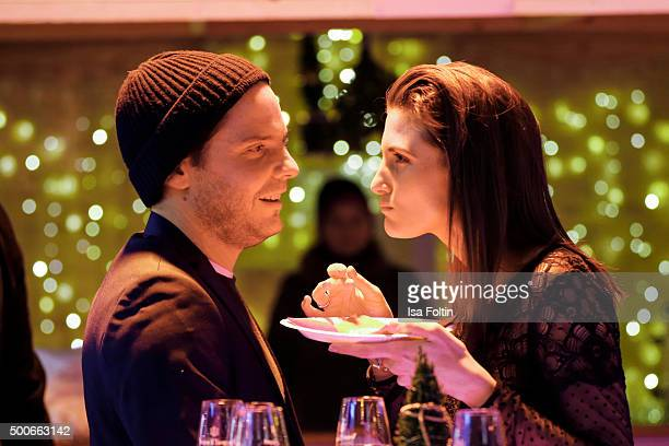 Daniel Bruehl and Felicitas Rombold attend the INTIMISSIMI Christmas Reception on December 09 2015 in Munich Germany