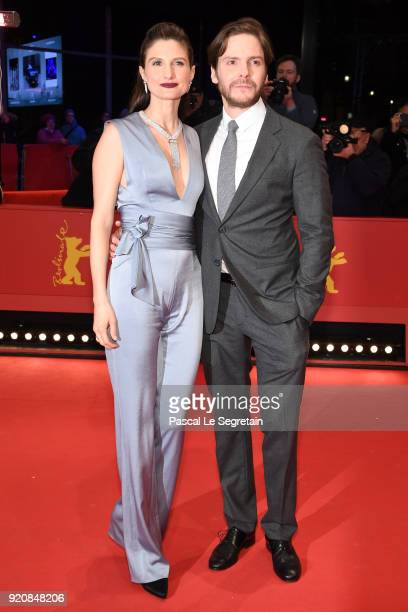Daniel Bruehl and his girlfriend Felicitas Rombold attend the '7 Days in Entebbe' premiere during the 68th Berlinale International Film Festival...