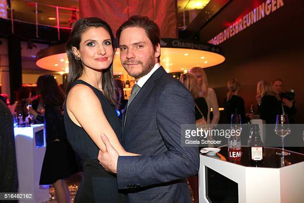 Daniel Bruehl and his girlfriend Felicitas Rombold during the 'Vogue loves Breuninger' fashion event on March 18 2016 in Stuttgart Germany