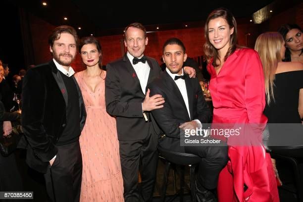 Daniel Bruehl and his wife Felicitas Rombold Wotan WilkeMoehring Andreas Bourani and Cosima Lohse during the aftershow party of the 24th Opera Gala...