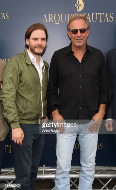 Daniel Bruehl and Kevin Costner attend the 'Arqueonautas Presents Kevin Coster Music Meets Fashion' at Spindler Klatt on July 8 2014 in Berlin Germany