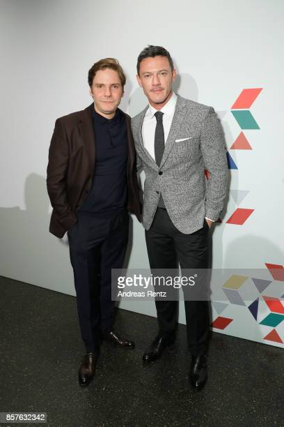 Daniel Bruehl and Luke Evans attend an EAMES Celebration by HUGO BOSS and Vitra Design Museum at Lapidarium on October 4 2017 in Berlin Germany