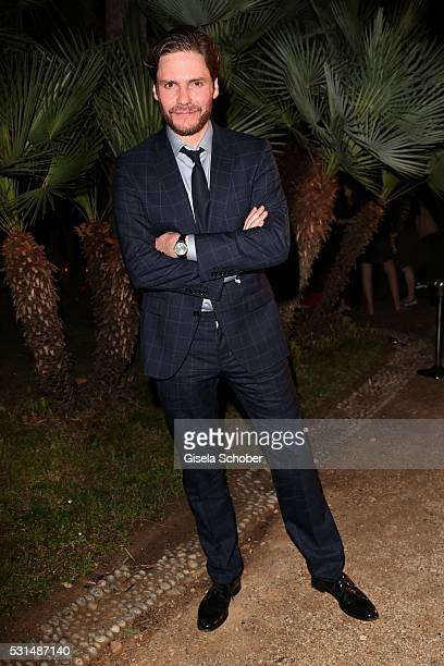 Daniel Bruehl wearing a suit by Hugo Boss during the German Films Reception at the annual 69th Cannes Film Festival at Villa Rothschild on May 14...