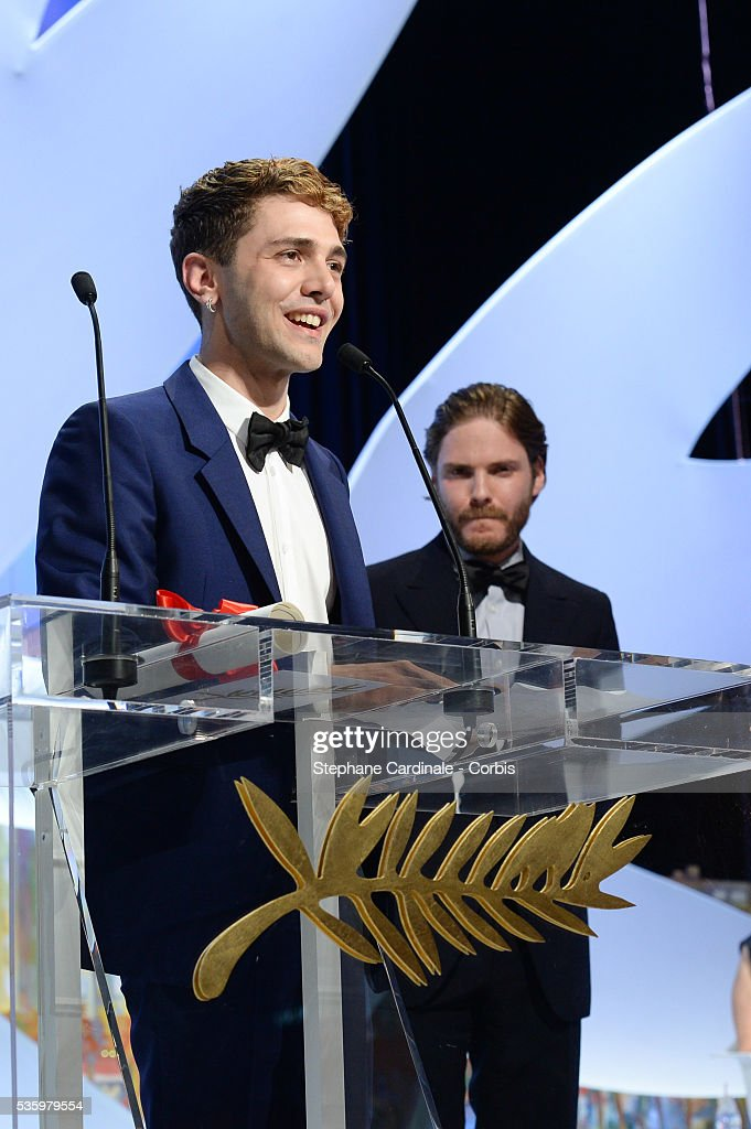 Daniel Bruhl and director Xavier Dolan after winning the Jury Prize at the Closing Ceremony during 67th Cannes Film Festival